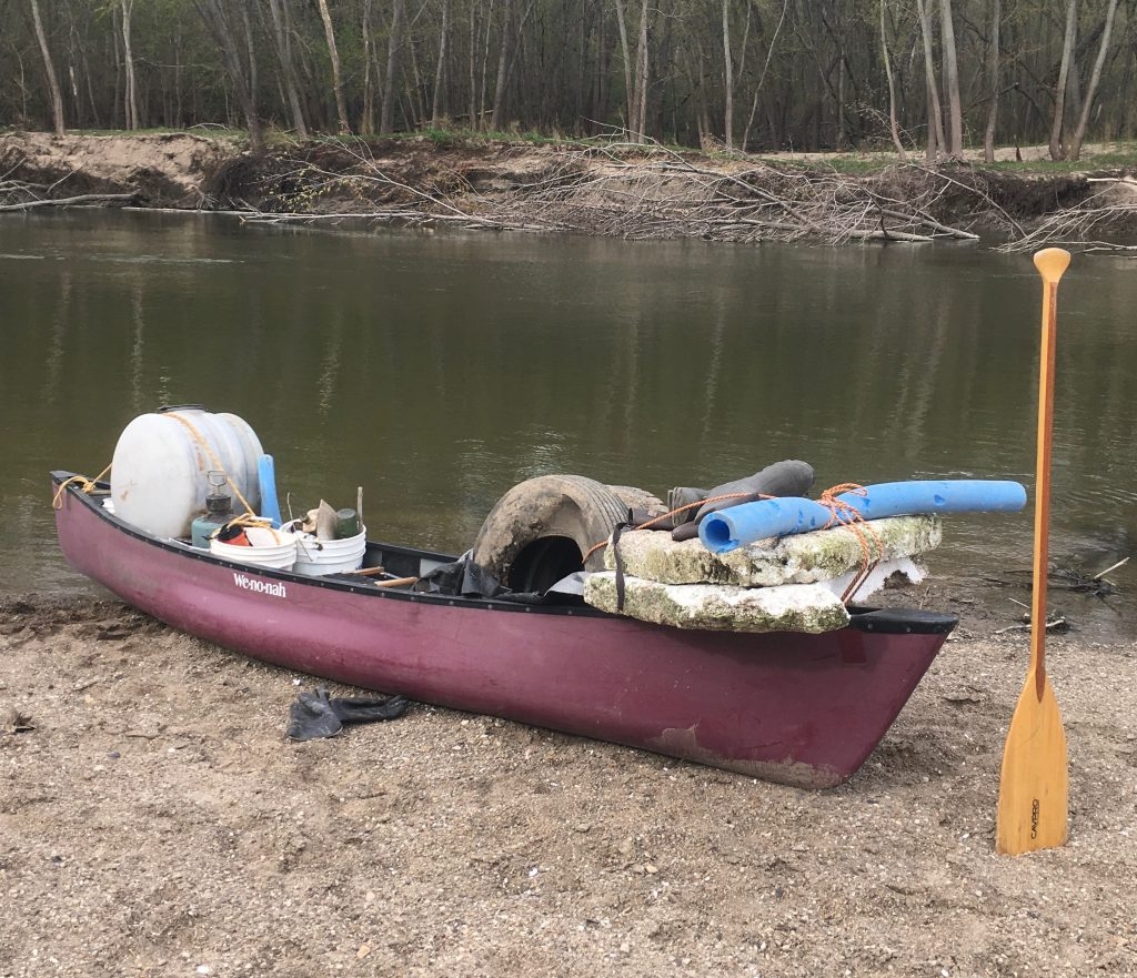 trash collected in canoe