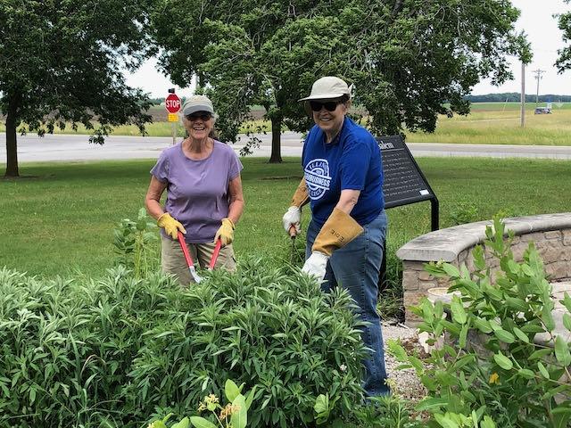 Volunteers maintaining pollinator way station