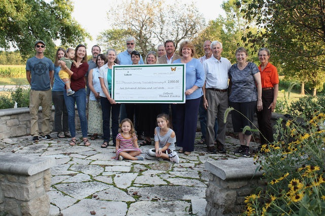 Menard Electric and CoBank present a donation to MCTG for rehabbing the Pollinator Waystation